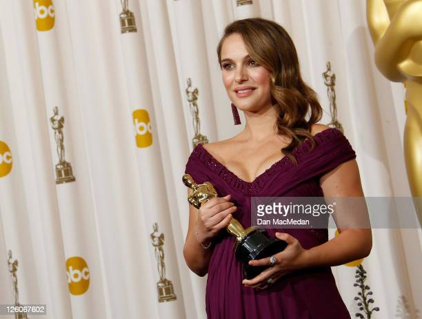 Actress Natalie Portman winner of the award for Best Actress in a Leading Role for 'Black Swan' poses in the press room at the 83rd Annual Academy...