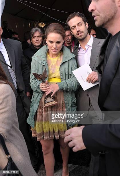 Actress Natalie Portman winner of the Best Female Lead award for 'Black Swan' and dancer Benjamin Millepied attend the 2011 Film Independent Spirit...