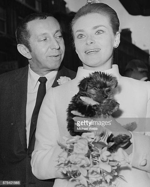 Actress Natalie Trundy and producer Arthur Jacobs pictured on their wedding day with the Yorkshire Terrier puppy which was a wedding present for the...