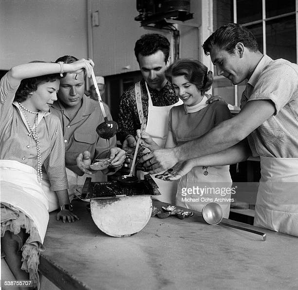 Actress Natalie Wood actor John Smith and musician Dick Contino and actress Leigh Snowden pour chocolate at a Wil Wright's ice cream parlor in Los...