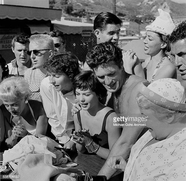 Actress Natalie Wood and actor Hugh OBrian gather with friends during the Thalians Beach Ball in MalibuCalifornia
