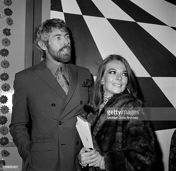Actress Natalie Wood and actor James Coburn at Premiere Party for The President's Analyst hosted by James Coburn in Los AngelesCA