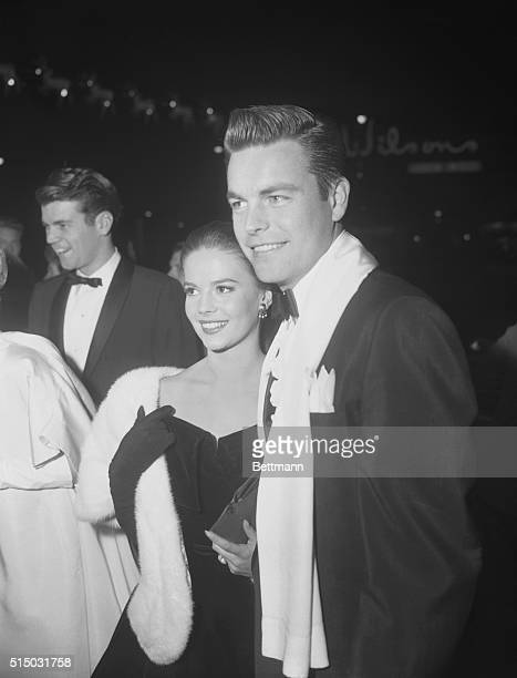 Actress Natalie Wood and actor Robert Wagner attending the premiere of the film, Peyton Place.
