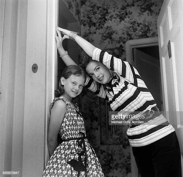 Actress Natalie Wood and her sister Lana Wood pose for a portrait at home in Los AngelesCA