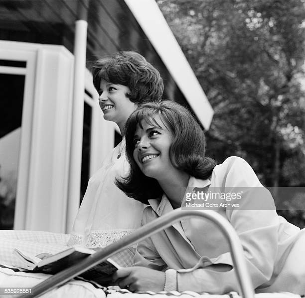 Actress Natalie Wood and sister Lana Wood pose for a portrait in Los AngelesCA