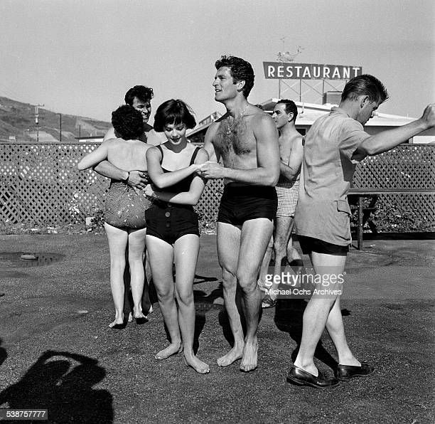Actress Natalie Wood dances with actor Hugh O'Brian during the Thalians Beach Ball in MalibuCalifornia