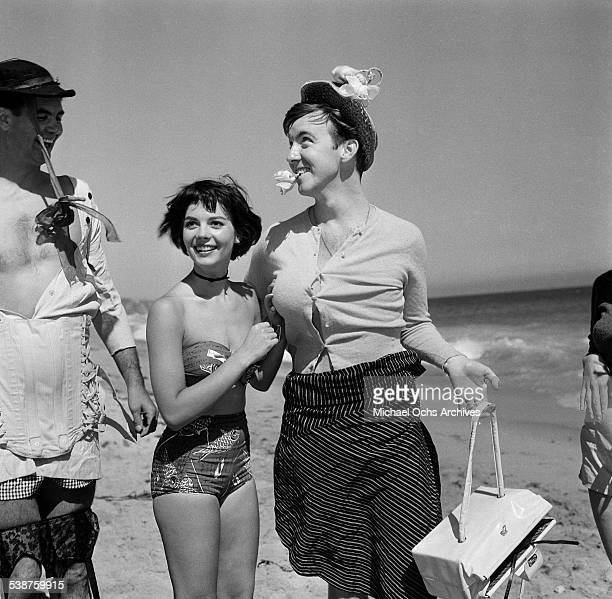 Actress Natalie Wood dresses Jack Hailey Jr during the Thalians Beach Ball in MalibuCalifornia