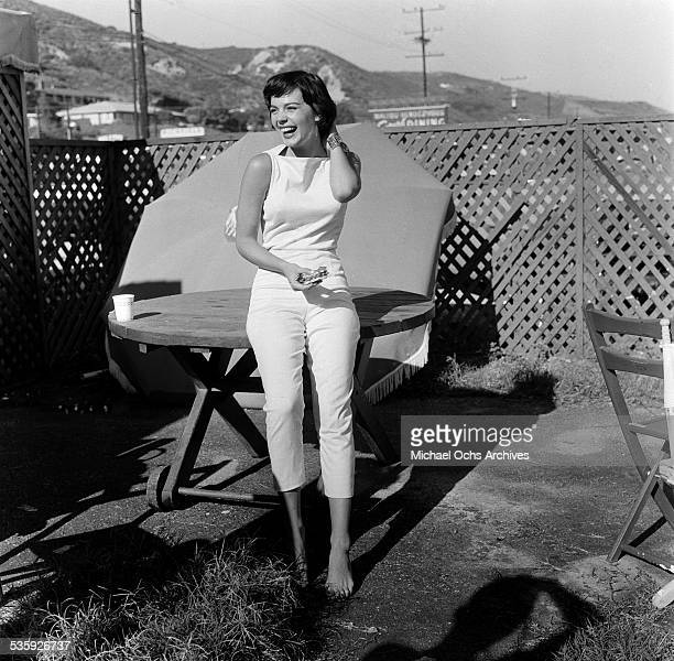 Actress Natalie Wood poses at the beach in Los AngelesCA