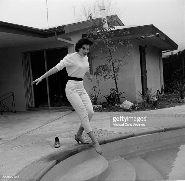 Actress Natalie Wood poses by her swimming pool at her home in Los AngelesCA