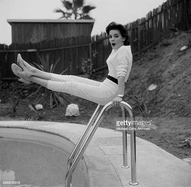 Actress Natalie Wood poses by her swimming pool at her home in Los Angeles,CA.