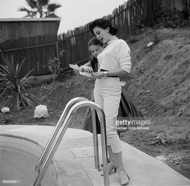 Actress Natalie Wood poses by her swimming pool with her sister Lana at her home in Los AngelesCA