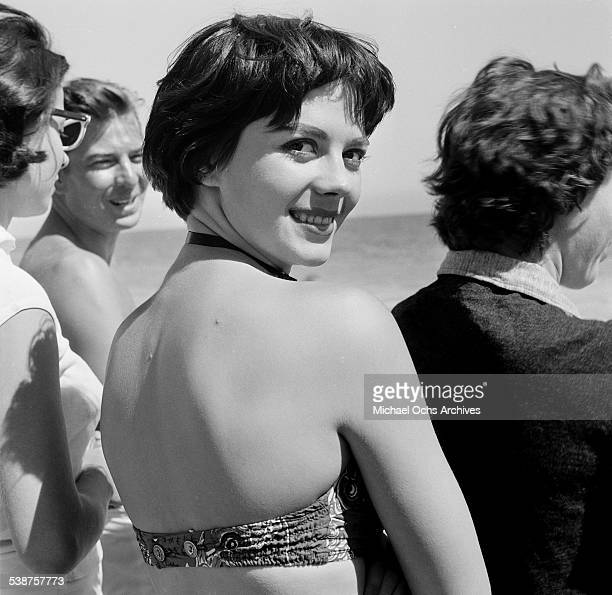 Actress Natalie Wood poses on the beach during the Thalians Beach Ball in MalibuCalifornia