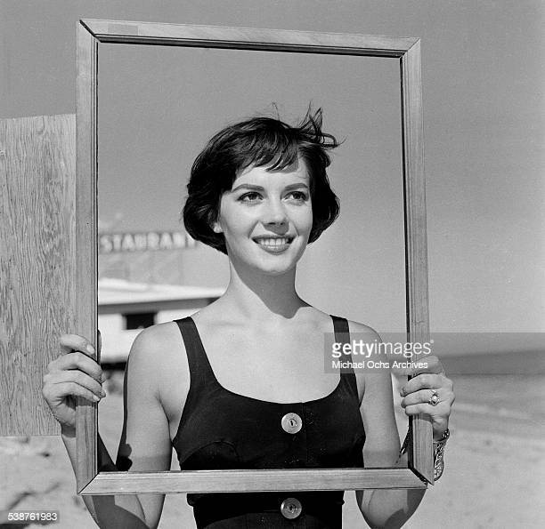 Actress Natalie Wood poses with a picture frame during the Thalians Beach Ball in MalibuCalifornia