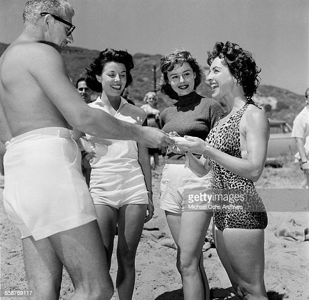 Actress Natalie Wood poses with actor Hugh O'Brian during the Thalians Beach Ball in MalibuCalifornia