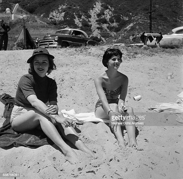 Actress Natalie Wood sits on the beach with Elaine Stewart during the Thalians Beach Ball in MalibuCalifornia
