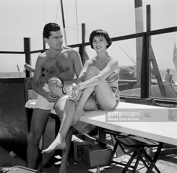 Actress Natalie Wood sits with a friend during the Thalians Beach Ball in MalibuCalifornia