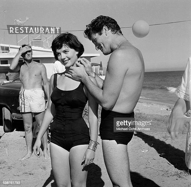 Actress Natalie Wood stands with actor Hugh O'Brian during the Thalians Beach Ball in MalibuCalifornia