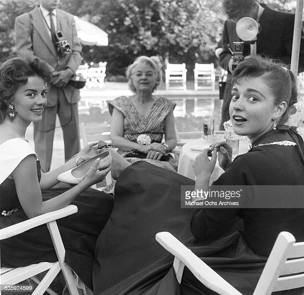 Actress Natalie Wood with Anna Maria Alberghetti attend the Jimmy McHugh Party in Los AngelesCA