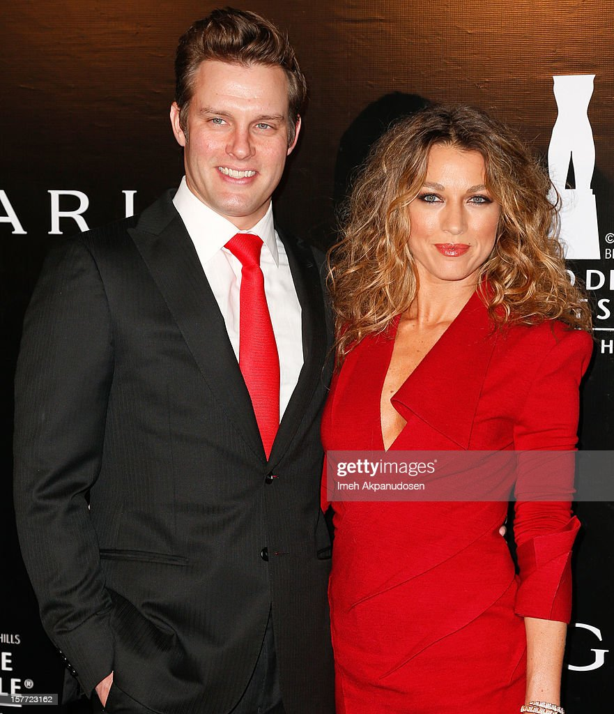 Actress Natalie Zea (R) and actor Travis Schuldt attend the Rodeo Drive Walk Of Style honoring BVLGARI and Mr. Nicola Bulgari held at Bulgari on December 5, 2012 in Beverly Hills, California.