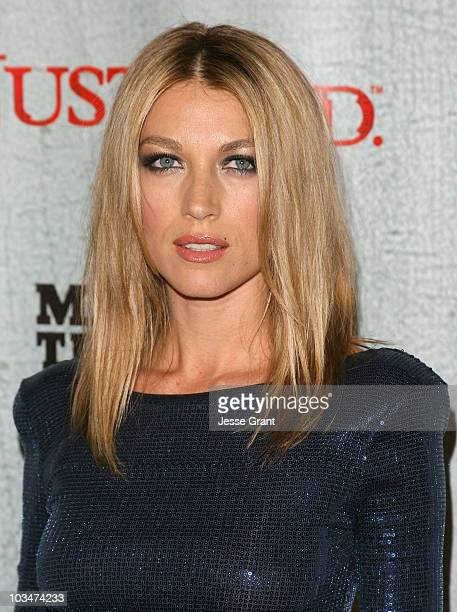 "Actress Natalie Zea arrives at the ""Justified"" Premiere Screening at the Directors Guild Theatre on March 8, 2010 in Los Angeles, California."