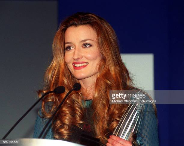 Actress Natascha McElhone who was nominated for Best British Actress in a Supporting Role accepts the Director of the Year Award on behalf of Peter...