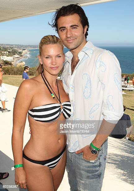 MALIBU CA AUGUST 09 Actress Natasha Henstridge and Darius pose during the Boost Mobil barbecue at The Project Beach House in Malibu California on...