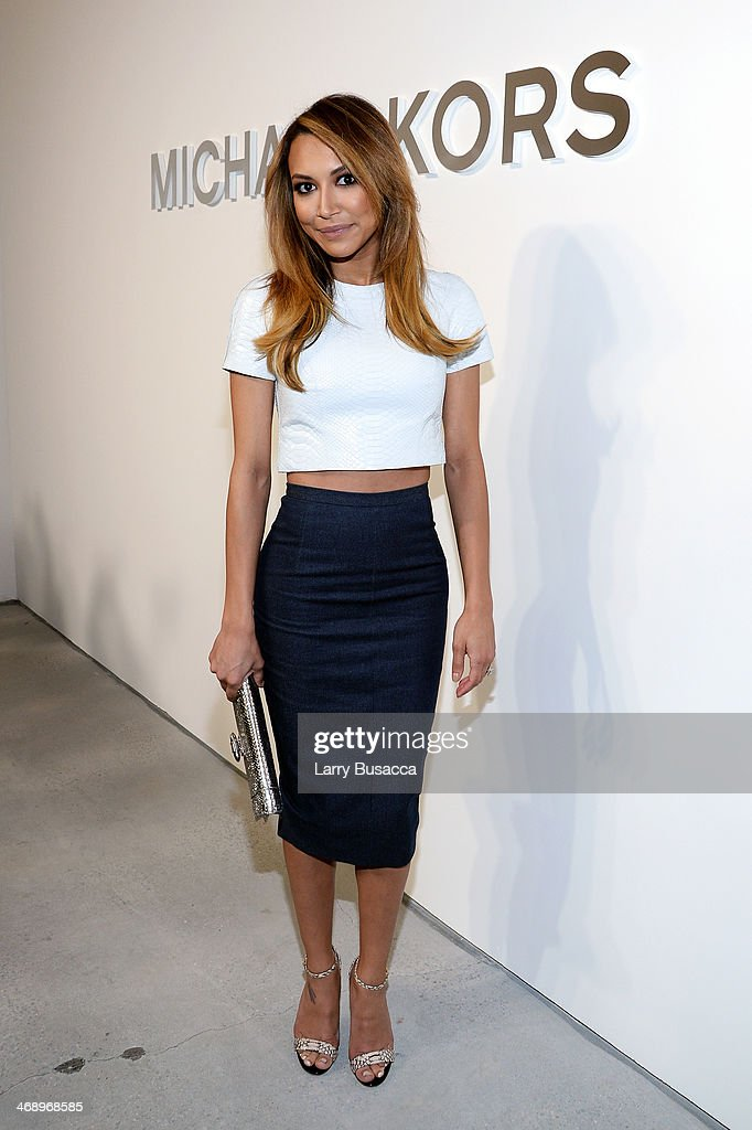 Actress Naya Rivera poses backstage at the Michael Kors fashion show during Mercedes-Benz Fashion Week Fall 2014 at Spring Studios on February 12, 2014 in New York City.