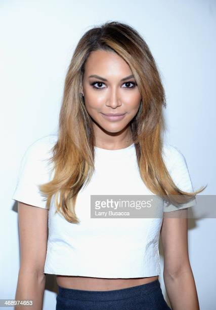 Actress Naya Rivera poses backstage at the Michael Kors fashion show during MercedesBenz Fashion Week Fall 2014 at Spring Studios on February 12 2014...