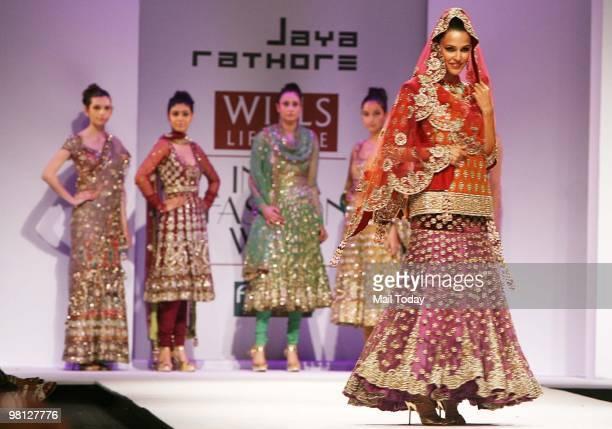 Actress Neha Dhupia walks the ramp for designer Jaya Rathore at day three of the Wills Lifestyle India Fashion Week Autumn Winter 2010 in New Delhi...