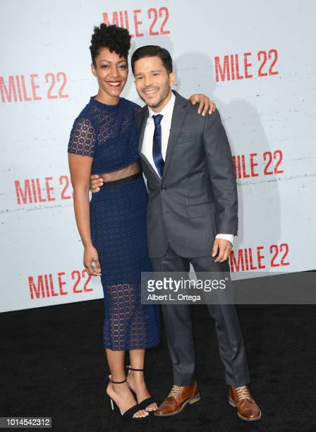 Actress Nemuna Ceesay and actor Carlo Alban arrive for the Premiere Of STX Films' 'Mile 22' held at Westwood Village Theatre on August 9 2018 in...