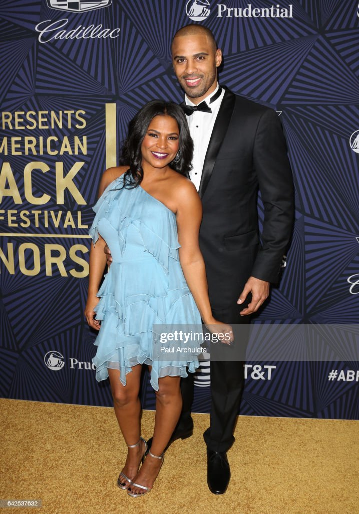 Actress Nia Long (L) and her Husband Ime Udoka (R) attend the BET's 2017 American Black Film Festival Honors Awards at The Beverly Hilton Hotel on February 17, 2017 in Beverly Hills, California.