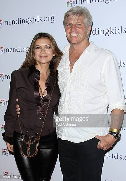 Actress Nia Peeples and her Husband ProSurfer Sam George attend the Mending Kids International's Rock Roll AllStars fundraising event on February 14...