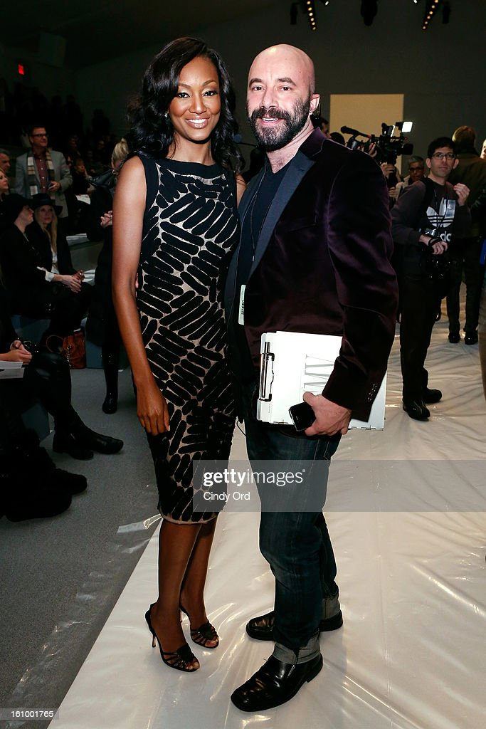 Actress Nichole Galicia and Frank Pulice, Vice President of Communications at Carmen Marc Valvo attends the Carmen Marc Valvo Fall 2013 fashion show during Mercedes-Benz Fashion Week at The Stage at Lincoln Center on February 8, 2013 in New York City.
