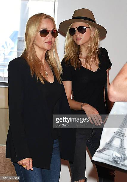 Actress Nicola Peltz and her mother model Claudia Peltz seen upon arrival at Narita International Airport on July 27 2014 in Tokyo Japan