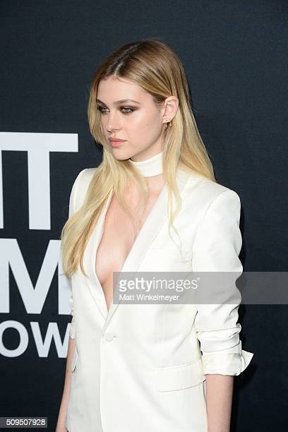 Actress Nicola Peltz in Saint Laurent by Hedi Slimane arrives at the Saint Laurent show at the Hollywood Palladium on February 10 2016 in Los Angeles...