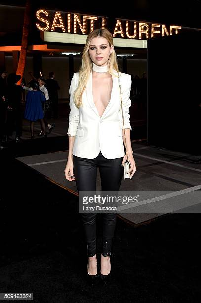 Actress Nicola Peltz in Saint Laurent by Hedi Slimane attends Saint Laurent at the Palladium on February 10 2016 in Los Angeles California for the...