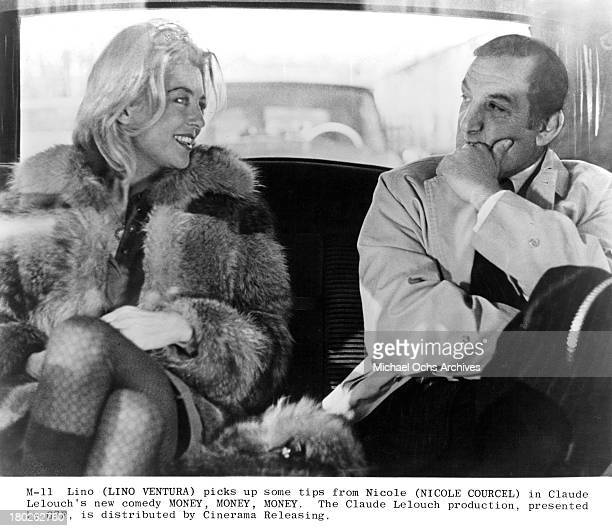 Actress Nicole Courcel and actor Lino Ventura on set of Cinerama Releasing movie Money Money Money