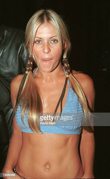 Actress Nicole Eggert poses at the Standard Hotel's Blue Room October 3 2002 in West Hollywood California