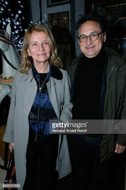 Actress Nicole Garcia and guest attend the Dinner in honor of Nathalie Baye at La Chope des Puces on April 30 2018 in SaintOuen France