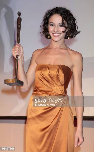 Actress Nicole Grimaudo shows her award during the 2010 Premio Afrodite cerimony at the Studios on April 14 2010 in Rome Italy