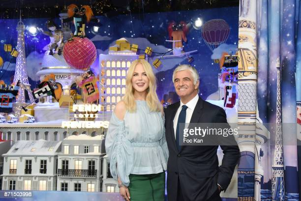 Actress Nicole Kidman and general director LVMH Antonio Belloni attend the 'Le Printemps' Christmas Decorations inauguration at Le Printemps on...