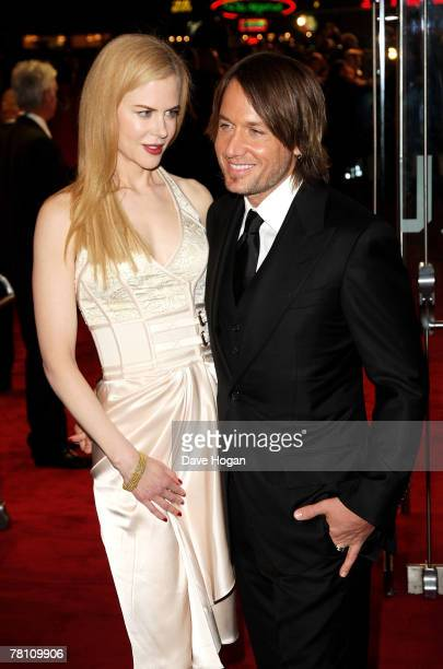 Actress Nicole Kidman and her husband musician Keith Urban arrive at the world premiere of The Golden Compass at the Odeon Leicester Square on...
