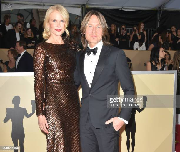 Actress Nicole Kidman and musician Keith Urban arrives for the 24th Annual Screen Actors Guild Awards at the Shrine Exposition Center on January 21...