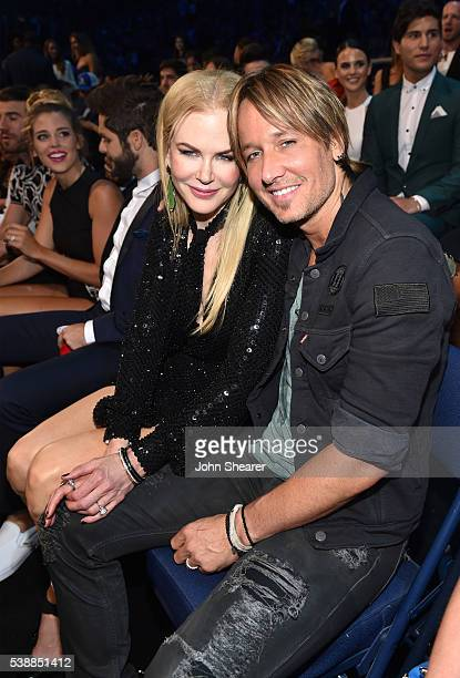 Actress Nicole Kidman and singer Keith Urban onstage during the 2016 CMT Music awards at the Bridgestone Arena on June 8 2016 in Nashville Tennessee