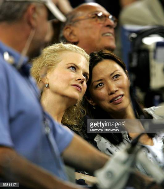 Actress Nicole Kidman and Wendi Murdoch, wife of Newscorp chairman Rupert Murdoch, look at the scoreboard during quarterfinal matches on Day 10 of...