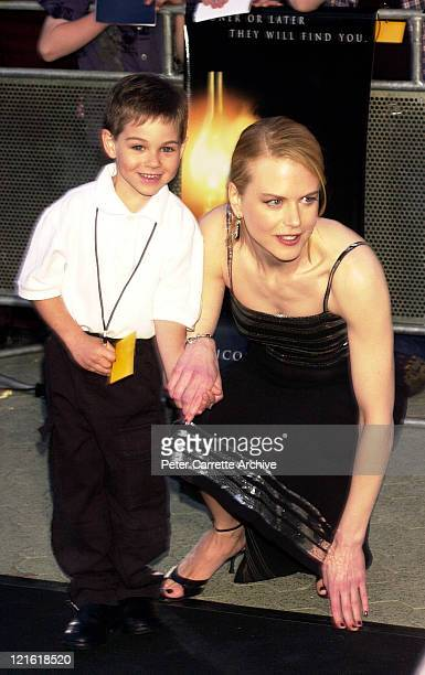 Actress Nicole Kidman arrives for the premiere of her new film 'The Others' with sevenyearold cancer patient Nicholas Powell at Hoyts Cinemas Fox...