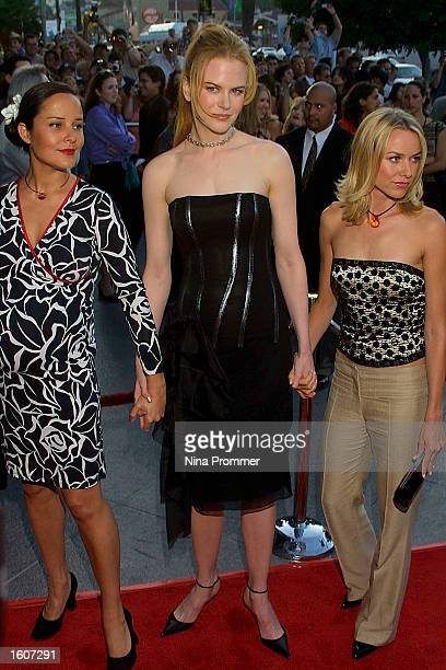 Actress Nicole Kidman center attends the premiere of The Others August 7 2001 at the Directors Guild of America in Los Angeles CA