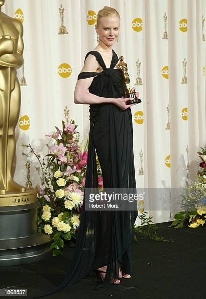 Actress Nicole Kidman poses with her Best Actress award for The Hours backstage during the 75th Annual Academy Awards at the Kodak Theater on March...