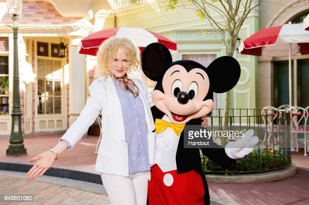Actress Nicole Kidman poses with Mickey Mouse in Magic Kingdom Park during a visit to the Walt Disney World Resort on February 20 2017 in Lake Buena...