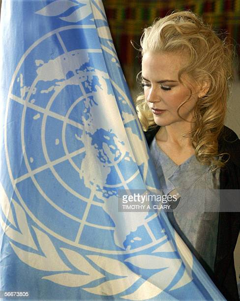 Actress Nicole Kidman poses with the United Nations Flag after being introduced as the new Goodwill Ambassador to the United Nations Development Fund...